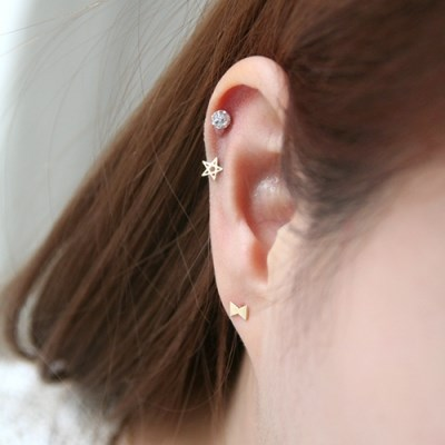 14K gold joe star piercing