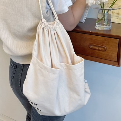 slowstitch string backpack ( ivory )