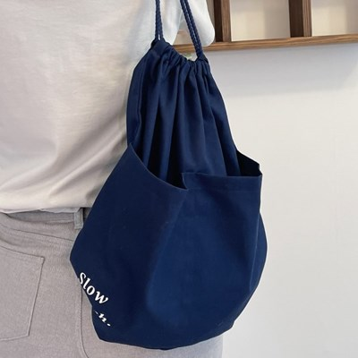 slowstitch string backpack ( navy )